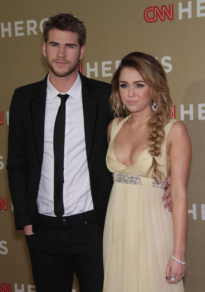 Miley Cyrus and Liam Hemsworth attended the CNN Heroes: All-Star Tribute 2011 on December 11, 2011 in Los Angeles, CA. Cyrus wore a sweet yellow dress that she complemented with a tousled side-swept hairstyle with fishtail braid on the side.