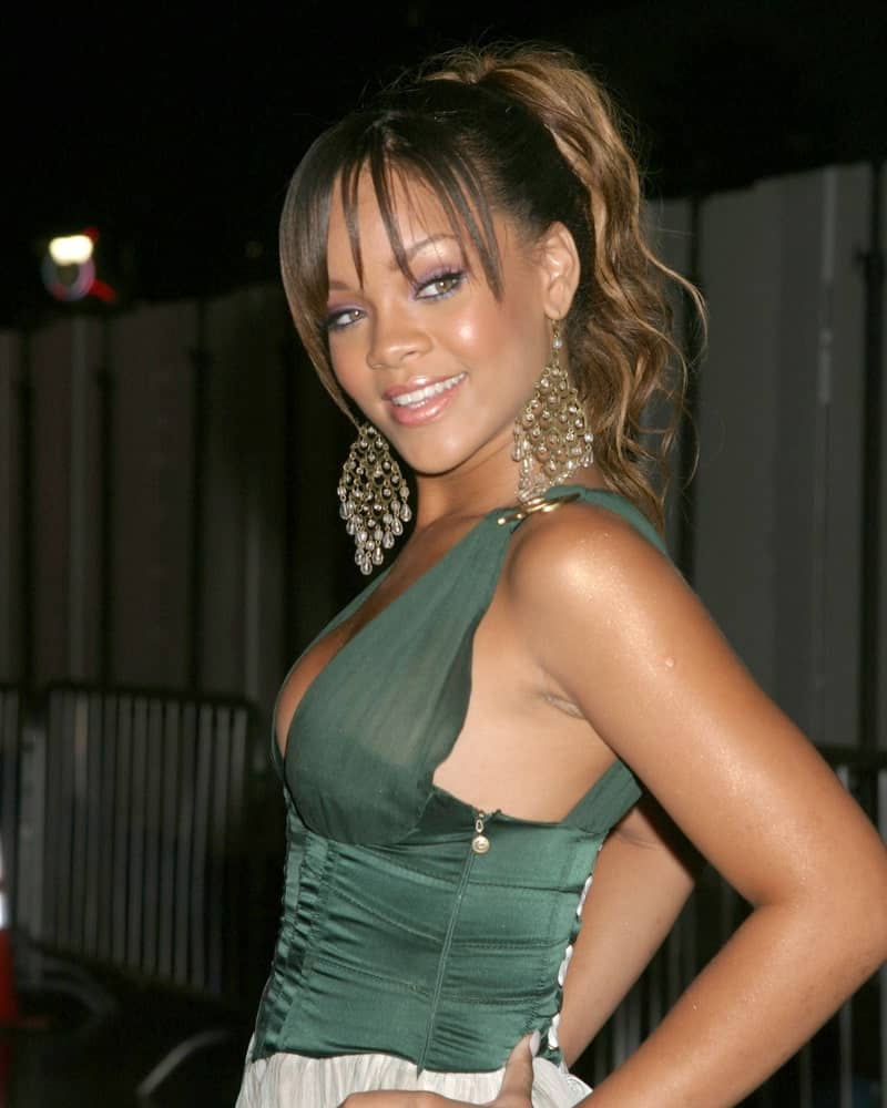 Rihanna was at the World Music Awards Kodak Theater in Los Angeles, CA on August 31, 2005. She came wearing a simple green bustier outfit to match her high ponytail with curly tips and wispy bangs.