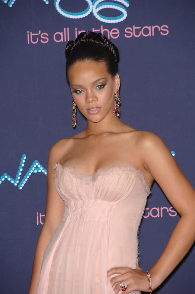 Singer Rhianna was at the 2006 BET Awards in Los Angeles on June 27, 2006, in Los Angeles, CA. She stole the show with her charming pink dress paired with a slick upstyle bun with braids at the top.