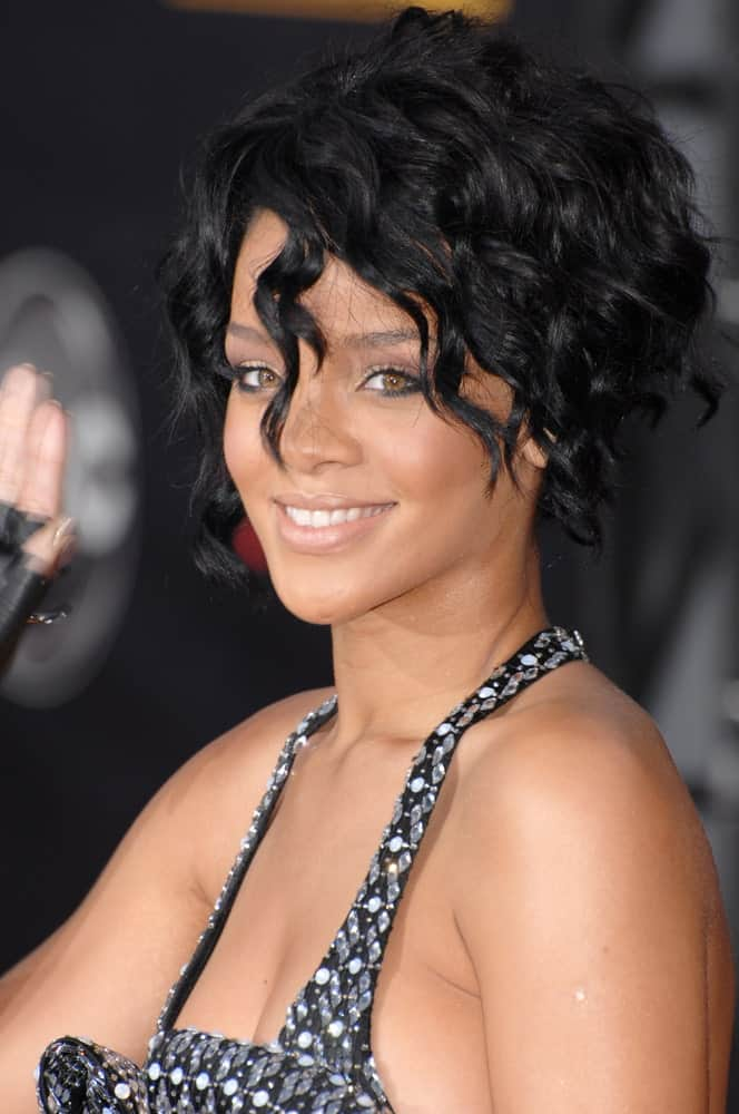 Rihanna paired her gorgeous bejeweled dress with a short and curly raven hair perfectly tousled at the 2007 American Music Awards at the Nokia Theatre, Los Angeles on November 19, 2007.