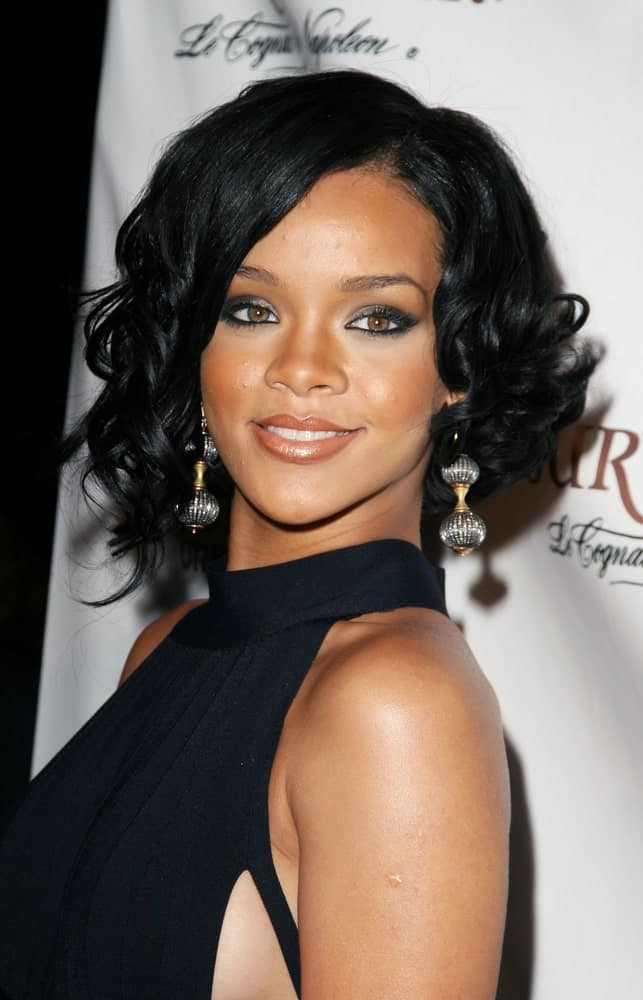 Rihanna was quite elegant with a vintage vibe to her black dress and short raven hairstyle with vintage curls at the tips when she arrived at the House of Courvoisier BET Awards After Party in Hollywood, California on June 26, 2007.