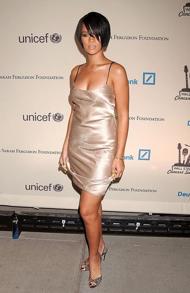 Rihanna wore a simple yet stunning champagne-colored dress with her short raven bob hairstyle with long side-swept bangs at the CIPRIANI Wall Street Concert Series to Benefit US Fund for UNICEF in New York on October 09, 2007.