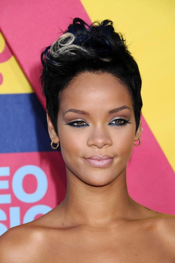 Rihanna's raven pixie hair was curly and swept up with a few tendrils highlighted at the 2008 MTV Video Music Awards at the Paramount Pictures Studios in Los Angeles, CA on September 7, 2008.