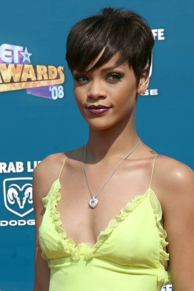 Rihanna was at the 2008 BET AWARDS held at the Shrine Auditorium in Los Angeles, CA on June 24, 2008. She paired her sunny yellow dress with some lovely make-up and a short side-swept raven pixie hairstyle.