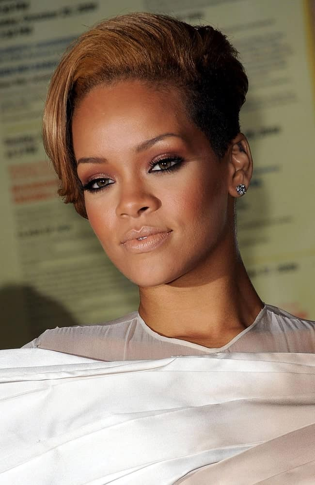 Rihanna's simple makeup and white dress went great with her side-swept short brown hairstyles with a shaved side at the GLAMOUR Women of the Year Awards in Carnegie Hall, New York, NY on November 9, 2009.