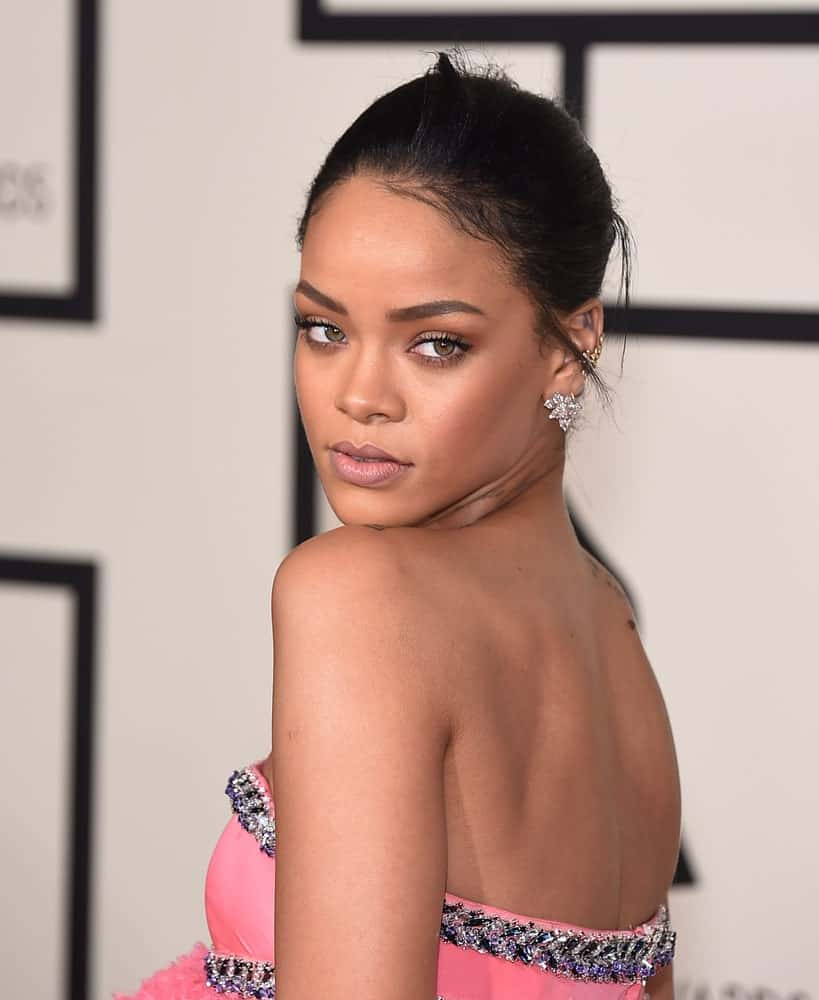 Rihanna attended the Grammy Awards 2015 on February 8, 2015, in Los Angeles, CA. She paired her charming pink strapless dress with a neat bun hairstyle with a few loose tendrils.