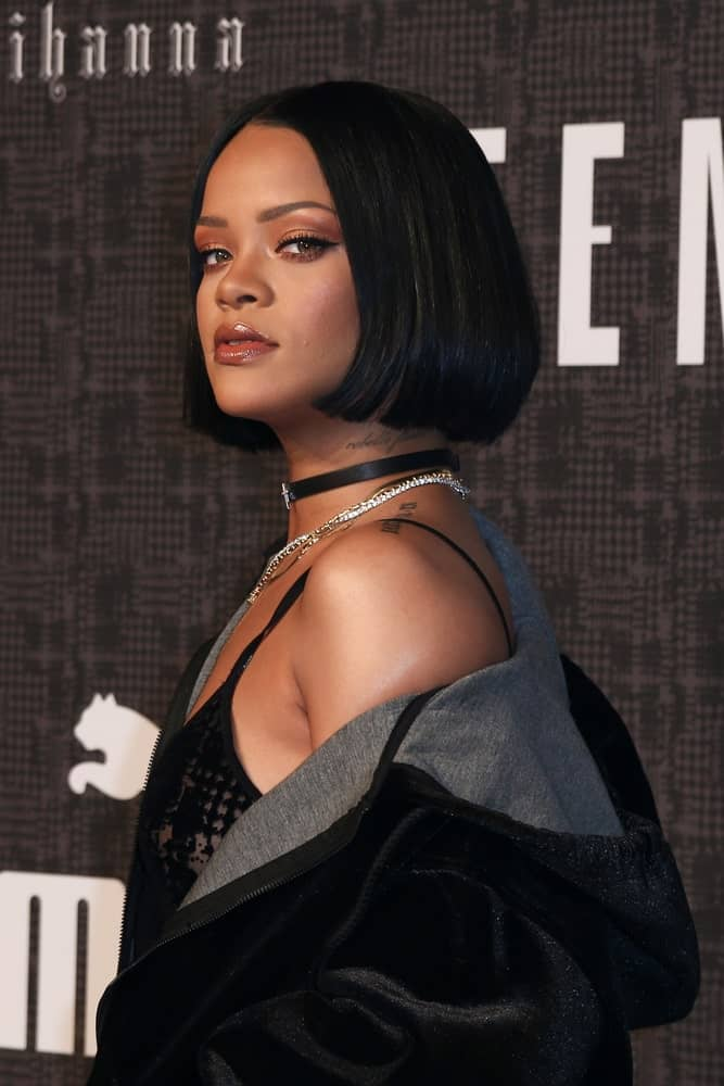 Recording artist Rihanna attended the FENTY PUMA by Rihanna AW16 Collection during Fall 2016 New York Fashion Week at 23 Wall Street on February 12, 2016, in New York City. She paired her casual black outfit with a short and straight bob hairstyle.