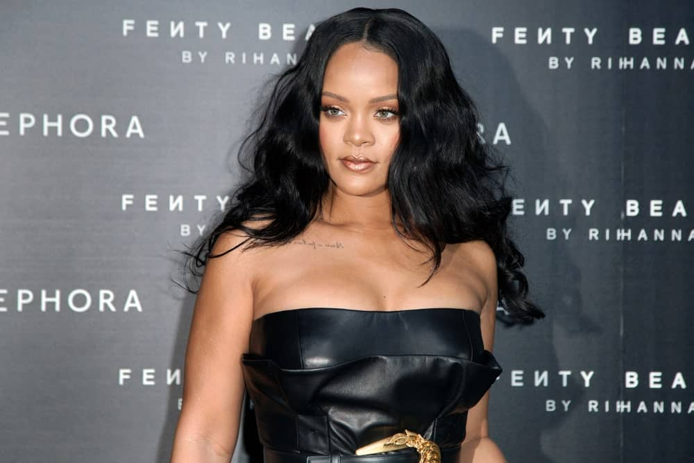 Rihanna matched her black leather sexy dress with her thick raven long hair that has a tousled wavy finish at the Sephora Fenty Beauty by Rihanna launch event on April 5, 2018, in Milan, Italy.