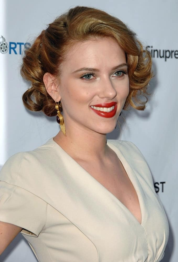Scarlett Johansson channeled her inner Marilyn Monroe with her white dress, red lips and short curly hairstyle at the 13th Annual Los Angeles Shorts Festival Opening Night, Laemmle's Sunset 5, West Hollywood in Los Angeles, CA on July 23, 2009.