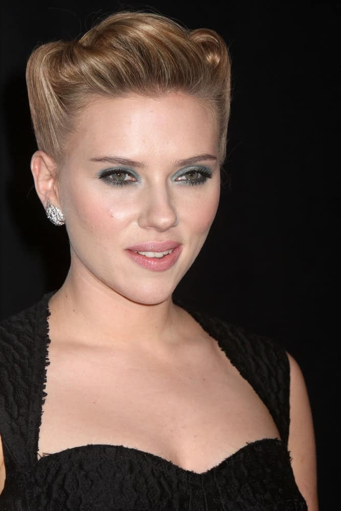 "Scarlett Johansson attended the premiere of ""We Bought A Zoo"" at the Ziegfeld Theatre on December 12, 2011, in New York City. She was gorgeous in her black dress and upstyle with buns."