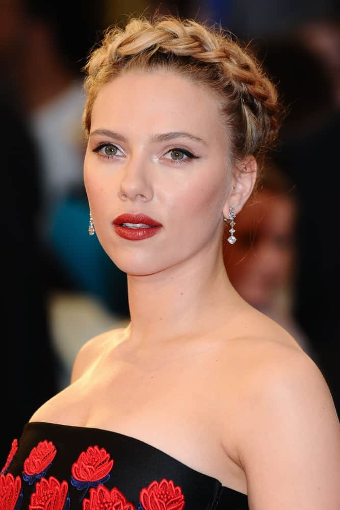 "Scarlett Johansson wore a black dress that has red roses embroidered on it to pair with her beautiful crown braid upstyle for the ""Avengers Assemble"" premiere at the Vue cinema Westfield in London on April 19, 2012."