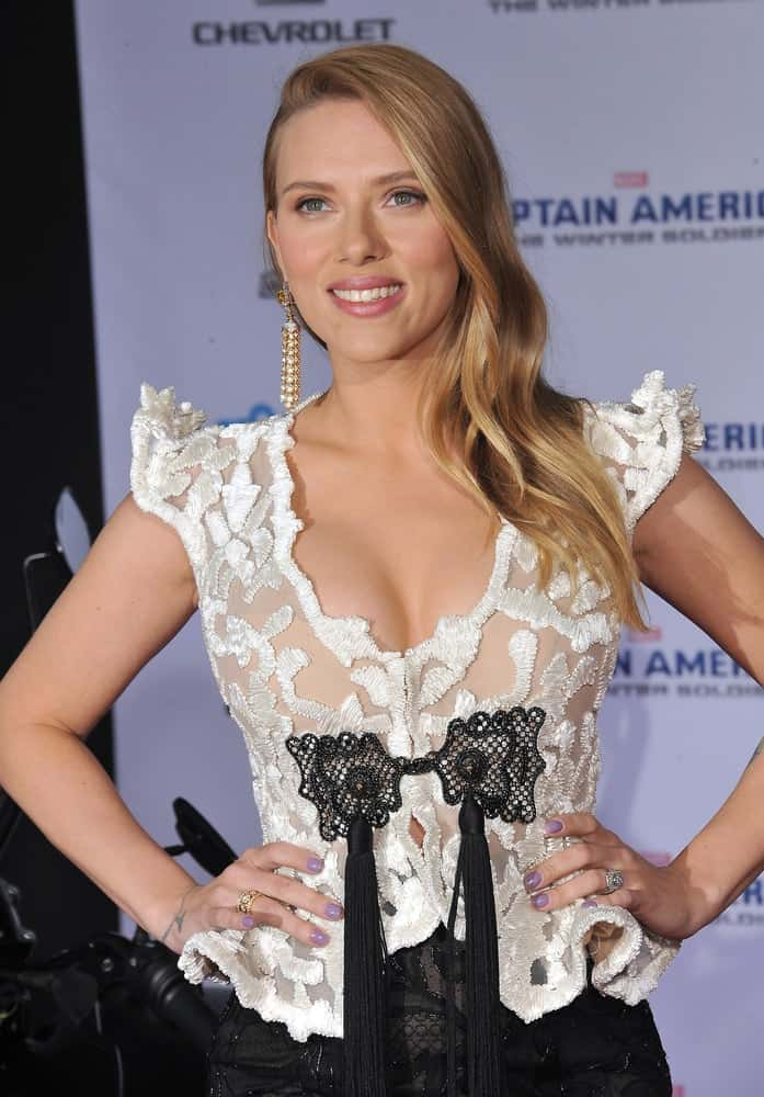 "On March 13, 2014, Scarlett Johansson wowed everyone with her lovely white and black embroidered dress that she paired with her long side-swept wavy hairstyle at the world premiere of her movie ""Captain America: The Winter Soldier"" at the El Capitan Theatre, Hollywood."