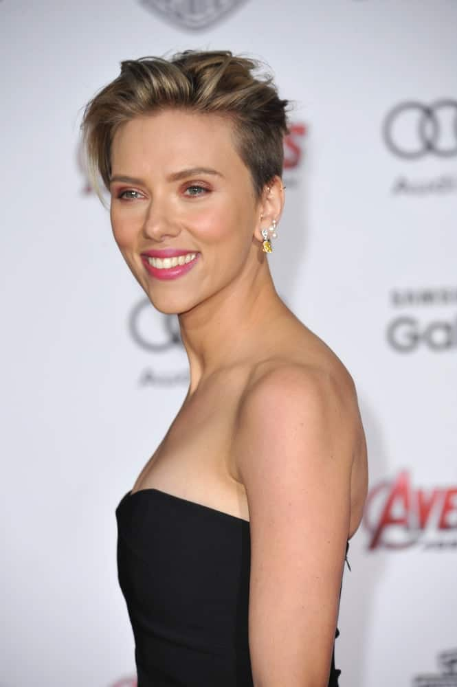 "On April 13, 2015, Scarlett Johansson was at the world premiere of her movie ""Avengers: Age of Ultron"" at the Dolby Theatre, Hollywood. She wore a sexy strapless black dress to go with her undercut pixie hairstyle with a tousled side-swept finish."