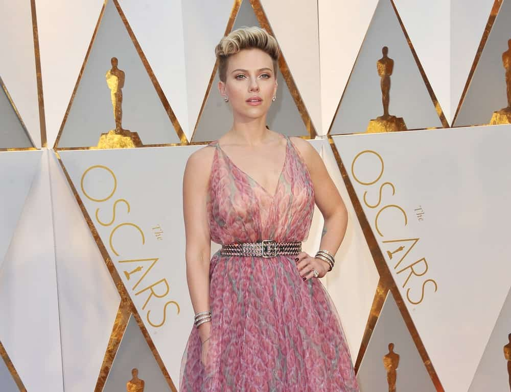 Scarlett Johansson was at the 89th Annual Academy Awards held at the Hollywood and Highland Center in Hollywood on February 26, 2017. She looked absolutely stunning in her floral pink sheer dress and her tousled upstyle with a slight pompadour look.