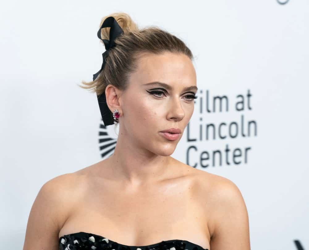 """On October 4, 2019, Scarlett Johansson wore a black strapless dress by Dior at the premiere of """"Marriage Story"""" at the 57th New York Film Festival at Lincoln Center Alice Tully Hall. She paired this with a classy highlighted high bun hairstyle with a black bow."""