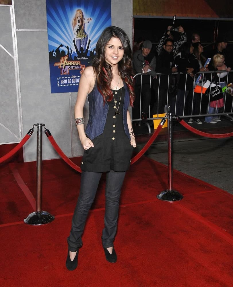 Selena Gomez went with a edgy fashion with her long, tight curls with red highlights at the Hannah Montana & Miley Cyrus Best of Both Worlds Concert 3D at the El Capitan Theatre in Los Angeles on January 17, 2008.