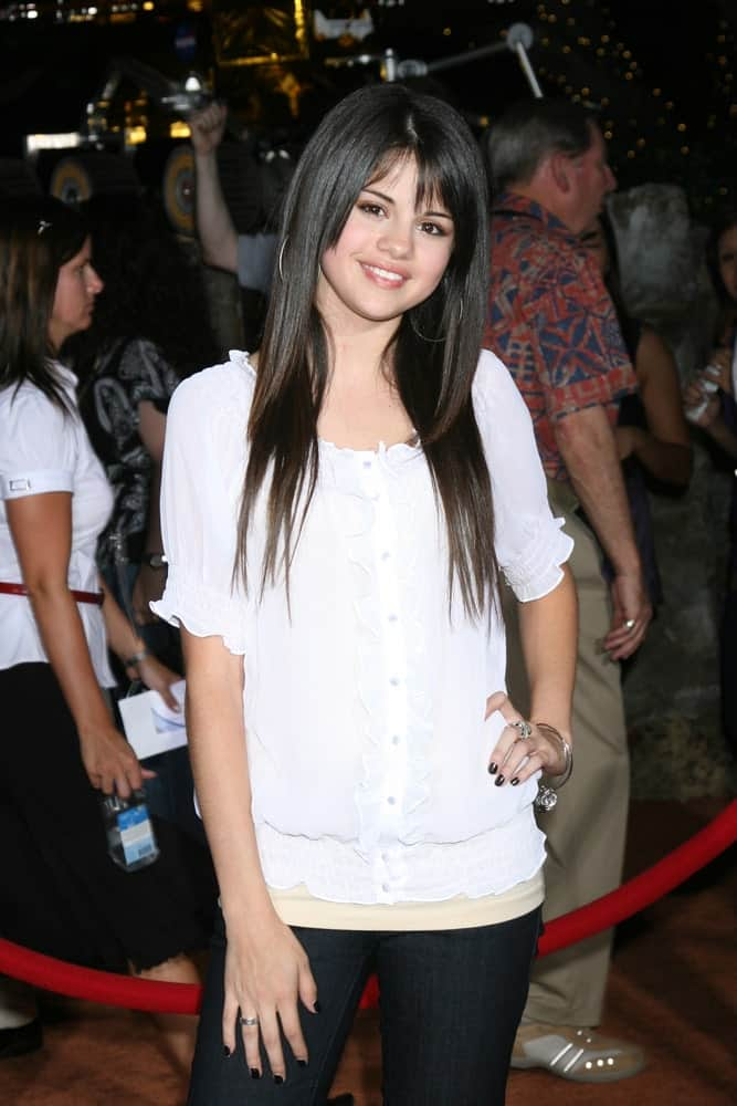 "Teenage actress and singer Selena Gomez was at the Wolrd Premiere of ""Wall-E"" at the Greek Theater in Los Angeles, CA on June 21, 2008. She went with a casual outfit to pair with her straight, layered and highlighted hairstyle."