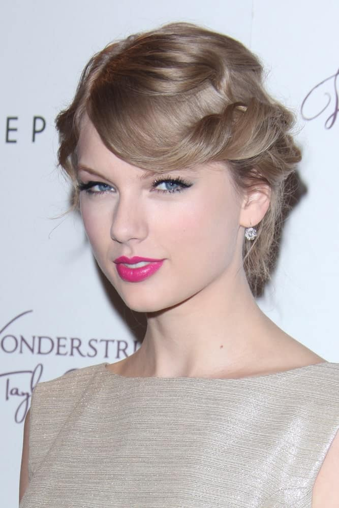 "Taylor Swift made an appearance at the ""Wonderstruck"" Fragrance Launch at Sephora Americana on October 18, 2011 exhibiting a curly updo with twisted side bangs."