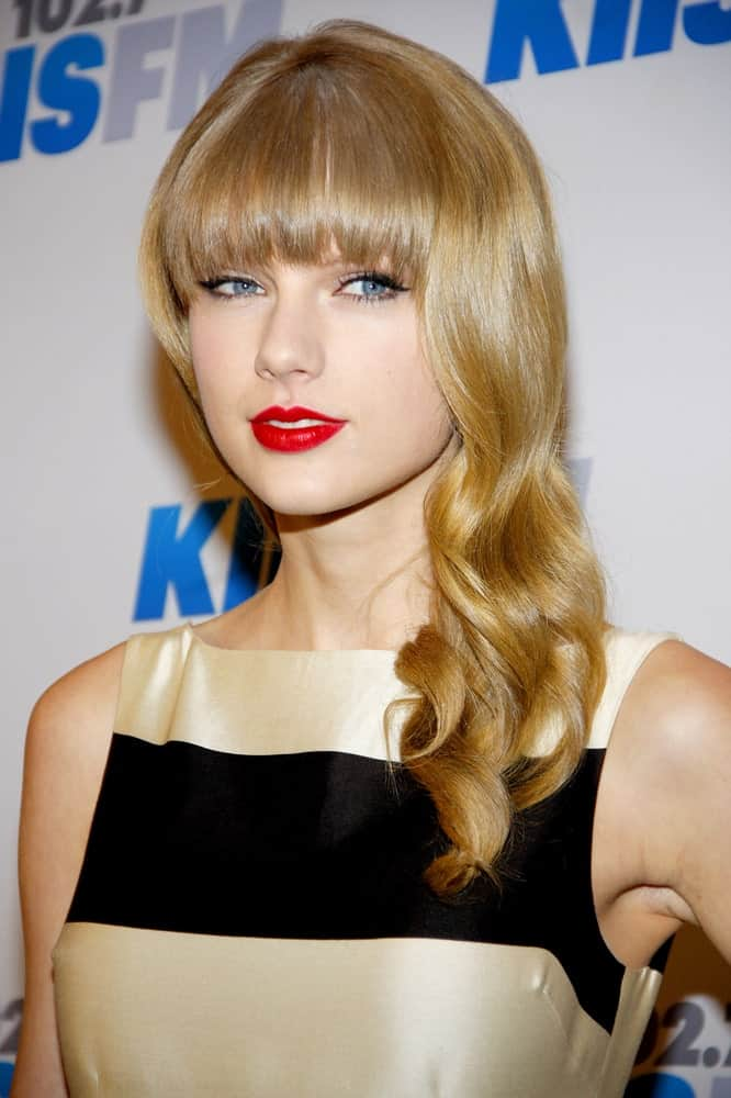Taylor Swift gathered her blonde wavy hair on one side during the KIIS FM's 2012 Jingle Ball held at the Nokia Theatre L.A. Live held on December 3rd.