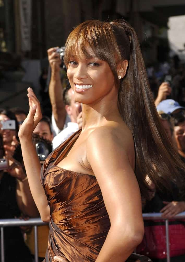 Tyra Banks was at the 34th Annual Daytime Emmy Awards held at The Kodak Theatre in Los Angeles on June 15, 2007. She paired her gorgeous bronze dress with a highlighted high ponytail that has eye-skimmer bangs.