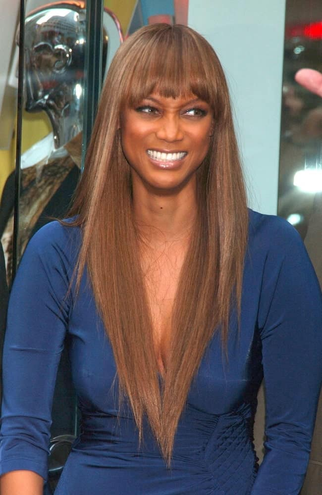 Tyra Banks attended the Just Cavalli Flagship Store Grand Opening Party in New York on September 07, 2007. She wore a classy blue dress with her silky smooth straight hairstyle with blunt bangs.