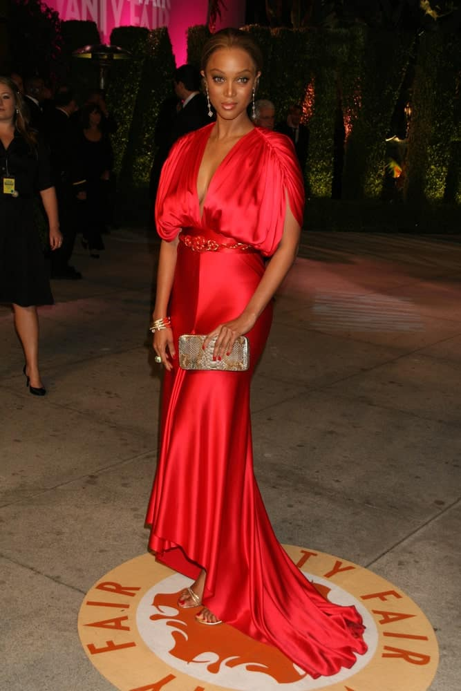 On February 25, 2007, Tyra Banks' lovely red dress was complemented by her classy and neat bun upstyle at the 2007 Vanity Fair Oscar Party held at the Mortons in West Hollywood, CA.