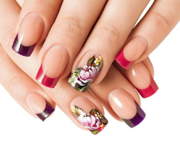 Close-up of a woman's hand with floral nail art manicure.