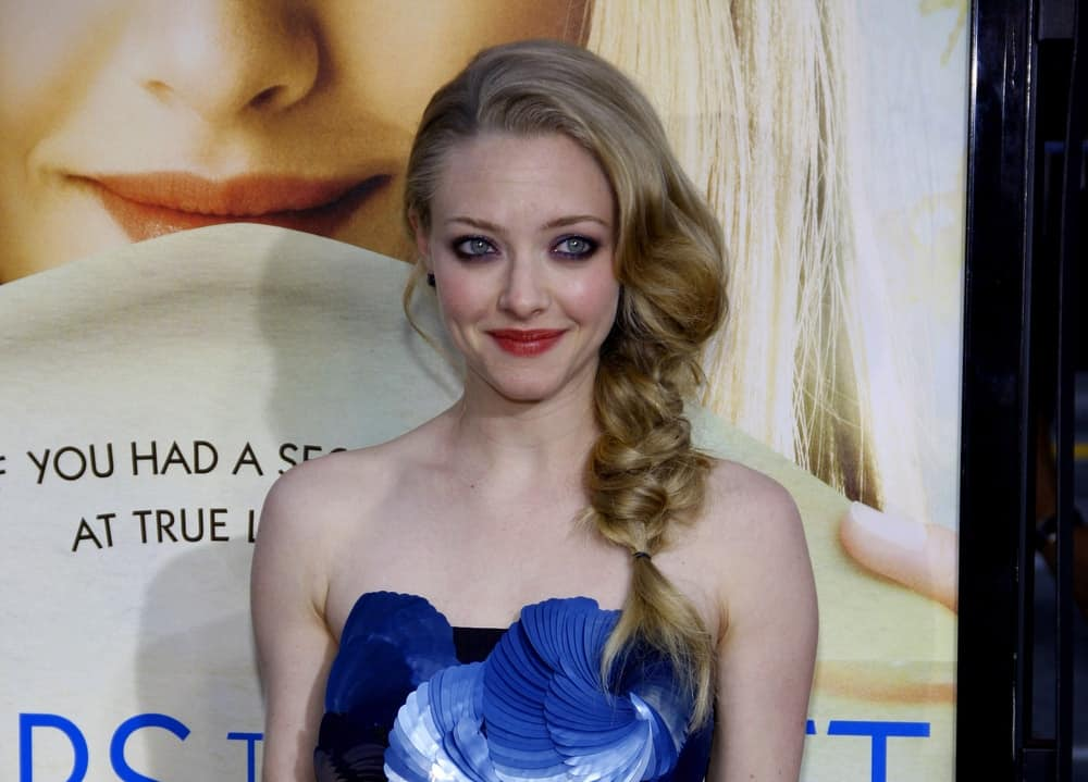 Amanda Seyfried was at the Los Angeles premiere of 'Letters To Juliet' held at the Grauman's Chinese Theater in Hollywood on May 11, 2010. She wore a beautiful blue strapless dress that she paired with a loose side-swept hairstyle that ends in a fishtail braid.