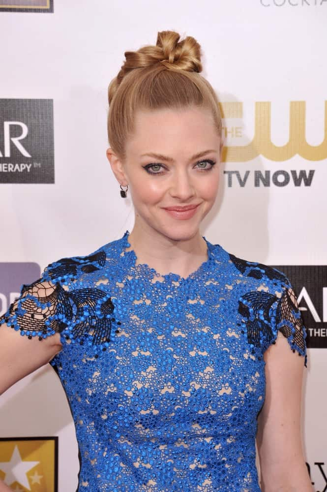 Amanda Seyfried was perfectly charming in her blue floral dress and neat top-knot bun upstyle that has a lovely sandy blond hue at the 18th Annual Critics' Choice Movie Awards at Barker Hangar, Santa Monica Airport on January 10, 2013, in Santa Monica, CA.