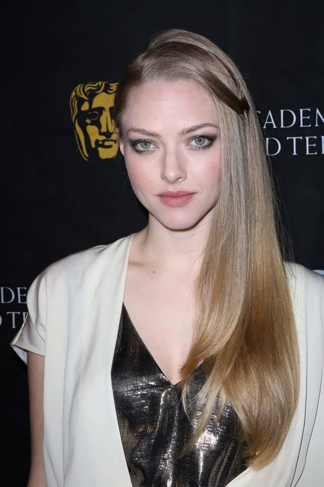 Amanda Seyfried flaunted her sexy eyes with smokey eye shadow and a long, side-swept sandy blond hairstyle that has a shiny straight finish at the BAFTA Los Angeles 2013 Awards Season Tea Party, Four Seasons Hotel in Los Angeles, CA on January 12, 2013.