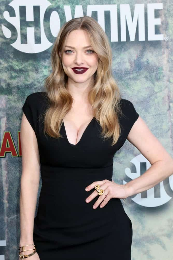 "Amanda Seyfried flaunted her sexy dark lips that went quite well with her simple black dress and wavy layered sandy blond hairstyle loose on her shoulders at the ""Twin Peaks"" Premiere Screening at The Theater at Ace Hotel on May 19, 2017, in Los Angeles, CA."
