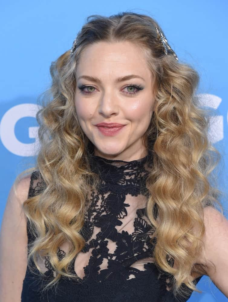 Amanda Seyfried wore a simple black dress that complemented her pinned half-up hairstyle with sandy blond curls on her shoulders at the 'Gringo' World Premiere on March 6, 2018 in Los Angeles, CA.