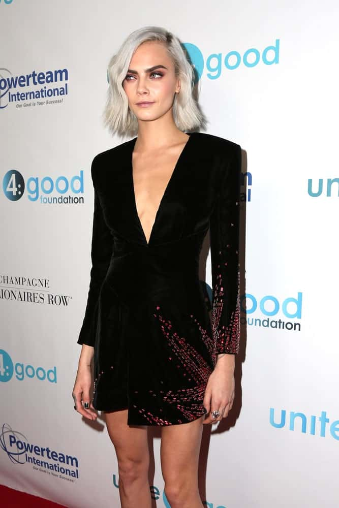 Cara Delevingne's gorgeous short dress is complemented by her white-blond bob hairstyle with loose side-swept bangs at the 4th Annual Unite4 Humanity Gala at the Beverly Wilshire Hotel on April 7, 2017, in Beverly Hills, CA.