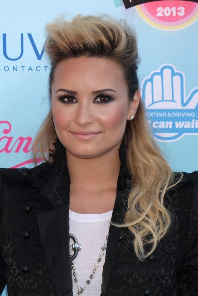 Demi Lovato went with a vintage 80's half-up hairstyle with a tall tousle up top and blond highlights at the 2013 Teen Choice Awards at the Gibson Amphitheater Universal on August 11, 2013, in Los Angeles, CA.
