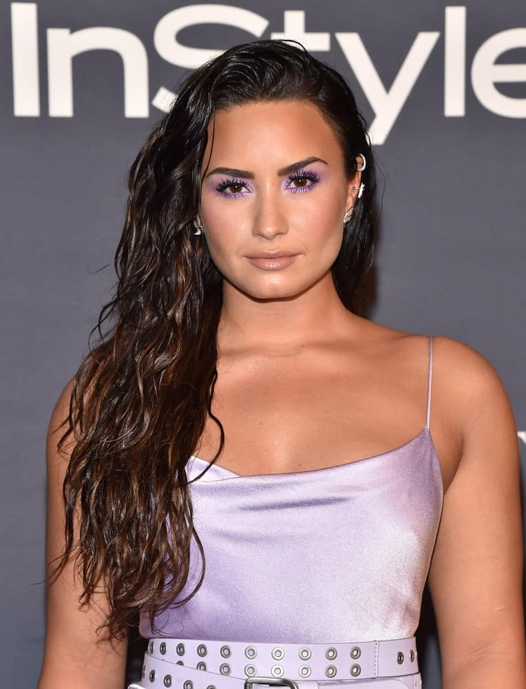 Demi Lovato paired her charming pearly dress with smokey eyes and a side-swept wavy hairstyle that has subtle highlights and a wet-look finish at the InStyle Awards on October 23, 2017, in Los Angeles, CA.