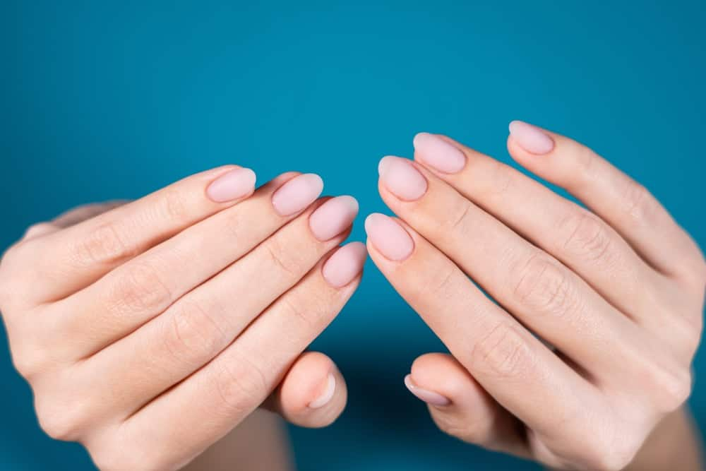 A pair of beautiful hands that are freshly manicured.
