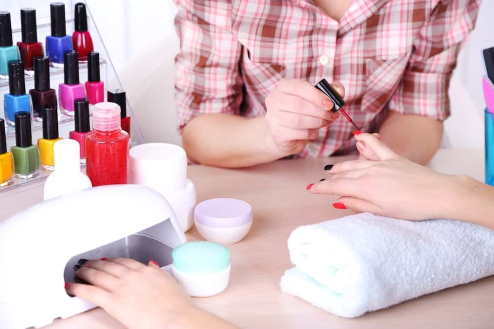 A woman having her nails done in a beauty salon.