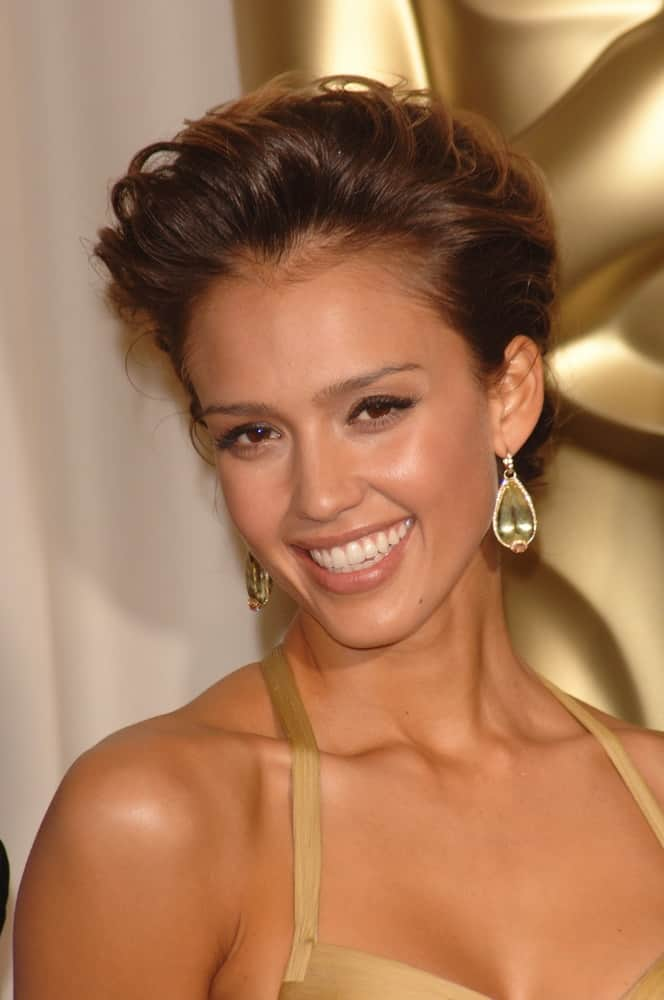 Jessica Alba wore a lovely golden dress that she complemented with a tousled upstyle with a slight pompadour look at the 78th Annual Academy Awards at the Kodak Theatre in Hollywood on March 5, 2006, in Los Angeles, CA.