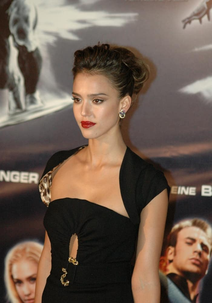 "On July 20, 2007, Jessica Alba wore an elegant black dress to match with her bun hairstyle that has a slightly tousled finish at the German premiere of the film ""Fantastic Four: Rise of the Silver Surfer"" in Sony Center, Potsdamer Platz, Berlin."