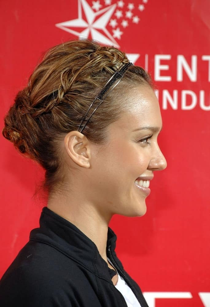 Jessica Alba was at a public appearance for the 12th Annual EIF Revlon Run/Walk For Women in Times Square, New York, NY on May 2, 2009. She paired her casual running outfit with a neat and complex upstyle with incorporated braids.