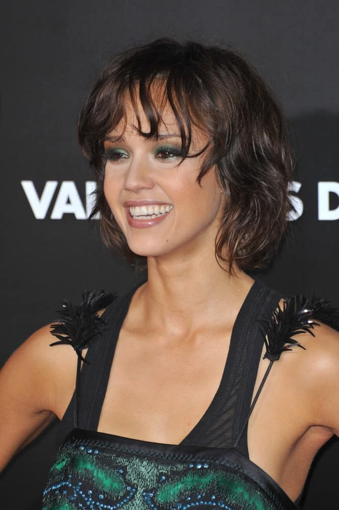 """Jessica Alba was at the world premiere of her new movie """"Valentine's Day"""" at Grauman's Chinese Theatre, Hollywood on February 8, 2010, in Los Angeles, CA. She paired her vintage dress with a short and tousled raven hairstyle that has a messy and wavy look."""