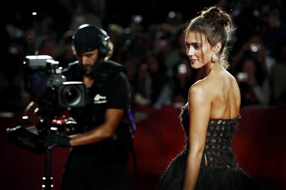 Jessica Alba attended the 'Machete' premiere during the 67th Venice Film Festival at Palazzo del Cinema on September 1, 2010, in Venice, Italy. She wore an elegant black dress that paired quite well with her messy top knot bun hairstyle with loose tendrils.