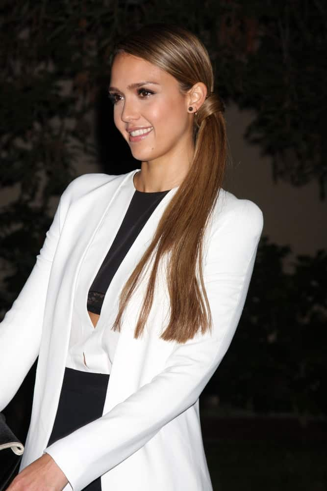 Jessica Alba was quite lovely and stylish in her white coat and smart outfit to pair with her long brown side ponytail at the 2012 Environmental Media Awards at Warner Brothers Studio on September 29, 2012, in Burbank, CA.