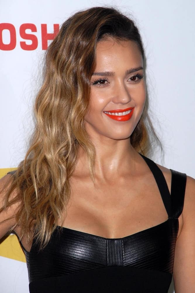 Jessica Alba looked amazing in her black leather dress and long side-swept curly hairstyle that was tousled, highlighted and loose at the Spike TV`S Video Game Awards 2012 at Sony Pictures Studios on December 7, 2012, in Culver City, CA.