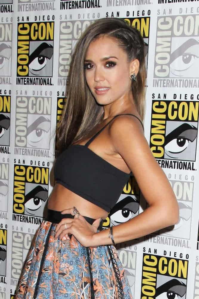 "Jessica Alba attended the ""Sin City: A Dame To Kill For"" Comic-Con Red Carpet at the Hilton San Diego Bayfront on July 26, 2014, in San Diego, CA. She wore a lovely two-piece dress with her side-swept straight and tousled hairstyle incorporated with braids."