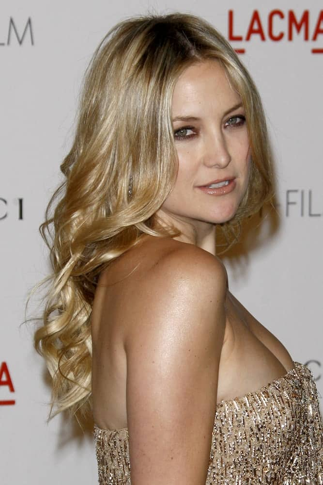 Kate Hudson was quite stunning in her golden sequined dress and long wavy hairstyle that has layers and subtle highlights at the LACMA Art + Film Gala at LA County Museum of Art on November 5, 2011, in Los Angeles, CA.