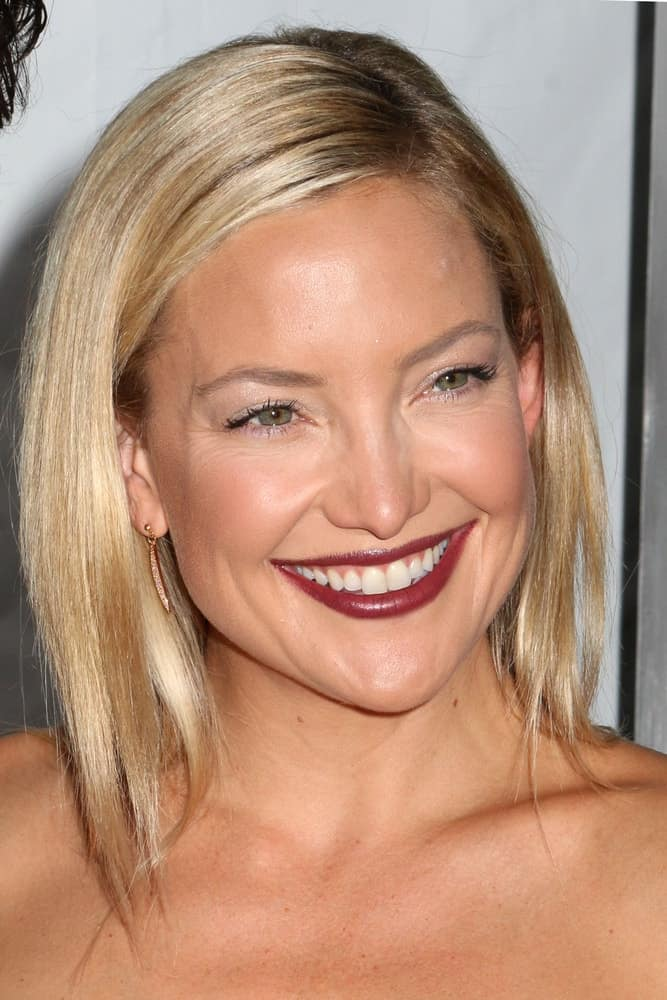 "Kate Hudson's bold dark lipstick went quite well with her black leather dress and straight blond hairstyle with a side-swept finish at the premiere of ""Wish I Was Here"" at the AMC Lincoln Square Theater on July 14, 2014, in New York City."