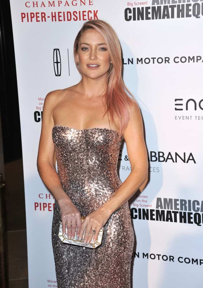 On October 21, 2014, Kate Hudson was at the 28th Annual American Cinematheque Award Gala honoring Matthew McConaughey at the Beverly Hilton Hotel. She came wearing a sexy silver strapless dress that she paired with a side-swept straight hairstyle that has pink highlights at the tips.