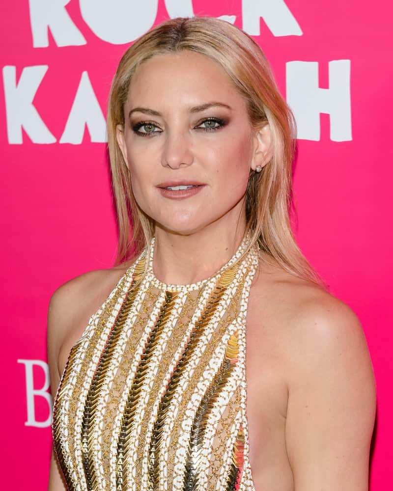 "Kate Hudson wore a fashion-forward outfit that flaunted her physique and straight sandy blond hairstyle tucked behind her ears when she arrived at the red carpet premiere of ""Rock The Kasbah"" in New York, NY on October 19, 2015."