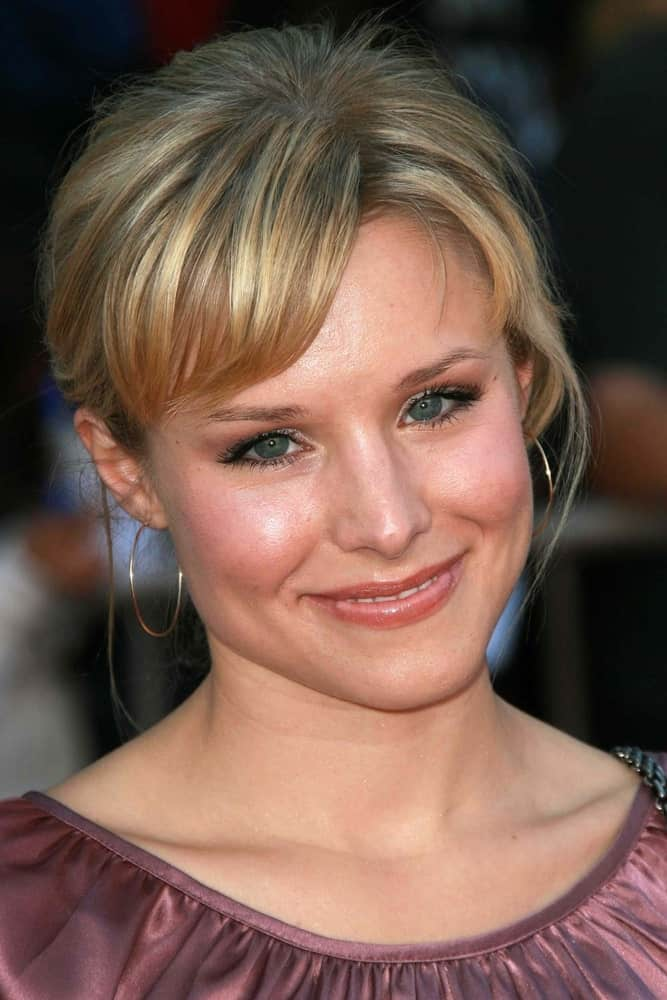 "Kristen Bell exhibited a sweet aura at the world premiere of ""The Game Plan"" on September 23, 2007. She wore a pink dress and a messy updo with short side-swept bangs."